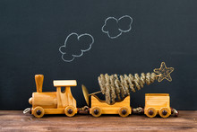 Christmas Concept, Old Wooden Toy Train With Christmas Tree, Steam On The Chalkboard Background