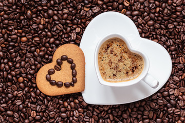 FototapetaHeart shaped cup and cookie on coffee beans background