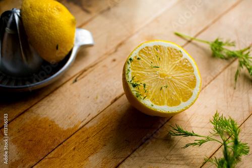 Stampe halved lemon on wooden surface