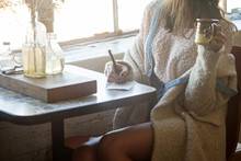 Woman Drinking Coffee And Writ...