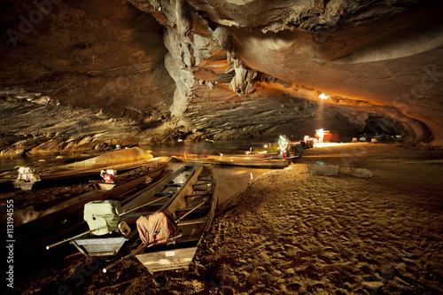 Canoes in cave Poster