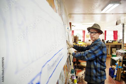 Typographer working on sign lettering in studio