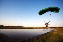 Parachuter Landing On Shallow ...