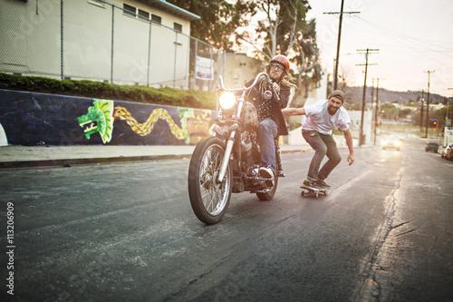 Plakat Skateboarder and biker enjoying on street