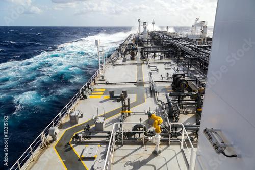 Valokuva  Big grey oil tanker underway in the open sea.