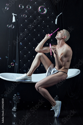 Fotografie, Obraz  Naked man sitting on the edge of the bath.