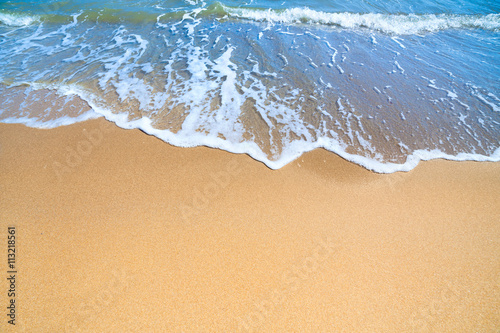 Keuken foto achterwand Strand Sea Beach with blue surf of wave and yellow sand