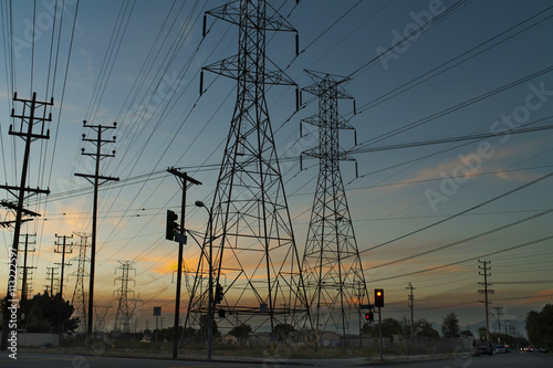 Silhouette of electricity pylons,
