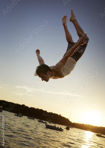 Deurstickers Magnolia USA, Massachusetts, Magnolia, Young man jumping into water