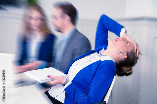 Fotografia, Obraz  Young female professional doesn't agree with the opinion of her colleagues on a