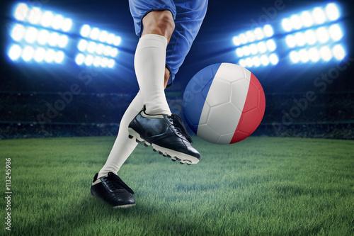 Leg kicking soccer ball in the stadium Wallpaper Mural