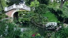 Little Bridge And Flora In Monceau Parc In Paris