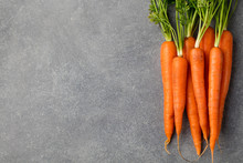 Fresh Carrots Bunch On A Grey Stone Background Top View Copy Space