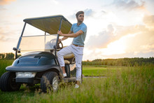 Yuong Guy Getting In Golf Cart