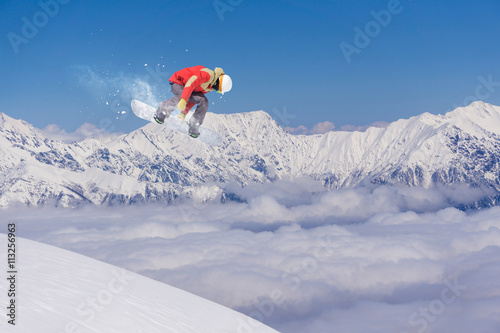 Fototapeta Snowboard Rider Jumping On Mountains Extreme Freeride Sport