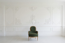 Living Room With Antique Stylish Green Armchair On Luxury White Wall Design Bas-relief Stucco Mouldings Roccoco Elements