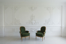 Luxury Clean Bright White Interior With A Old Antique Vintage Green Chairs Over Wall Design Bas-relief Stucco Mouldings Roccoco Elements