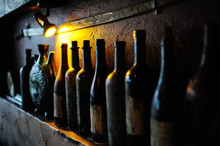 Bottles With Old Wine In A Cellar