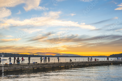Foto op Canvas Baksteen scene of walk way on the lake when sunset.