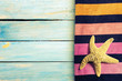 Summer beach accesories and marine life on wooden boards