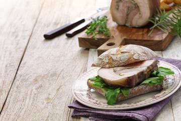 homemade porchetta panini, italian roast pork sandwich