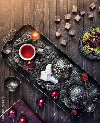 Turkish delights and tea on the table in Istanbul Fototapet