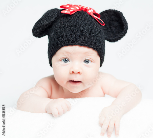 Newborn Baby With Hat On The Head Lying On Blanket Smiling Cute