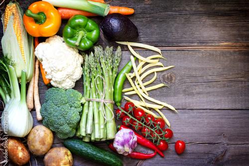Fotobehang Fresh vegetables on a vintage wooden background