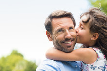 Girl Kissing Father