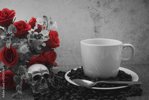 Wall Murals Cafe Coffee cup and beans on wooden in dark