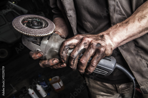 Dirty hands with angle grinder Poster