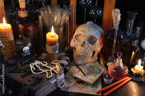 Staande foto Vlees Magic still life with tarot cards, skull, book and burning candles