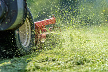 Lawnmover At Work In A Meadow