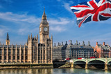 Fototapeta Londyn - Big Ben with flag of United Kingdom in London, UK