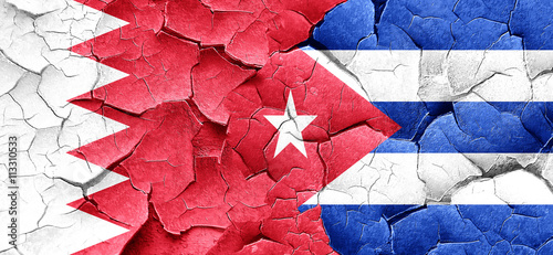 Bahrain flag with cuba flag on a grunge cracked wall Wallpaper Mural