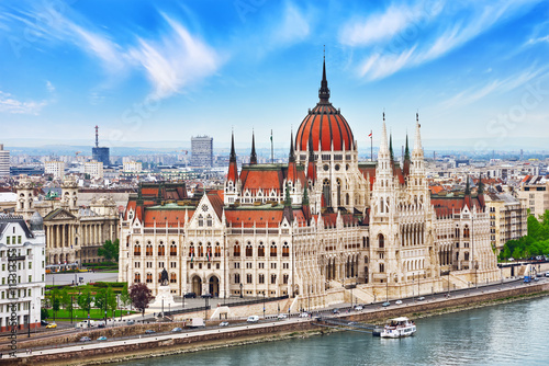 Photo  Hungarian Parliament at daytime. Budapest. View from Old Fisherm