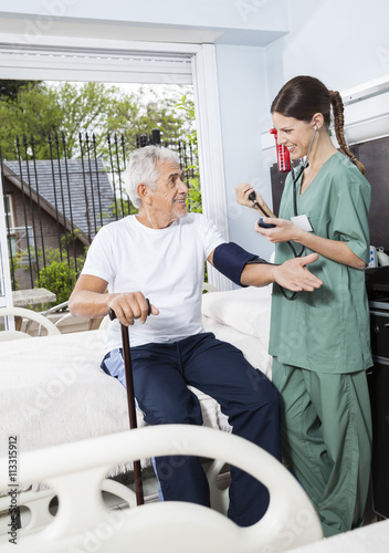a94670e120e Nurse Checking Blood Pressure Of Patient In Rehab Center. By Tyler Olson