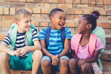 Happy School Kids Sitting Toge...