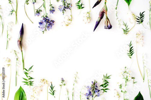 In de dag Lelietje van dalen floral frame with purple iris flower, lily of the valley, branches, leaves and petals isolated on white background. flat lay, overhead view