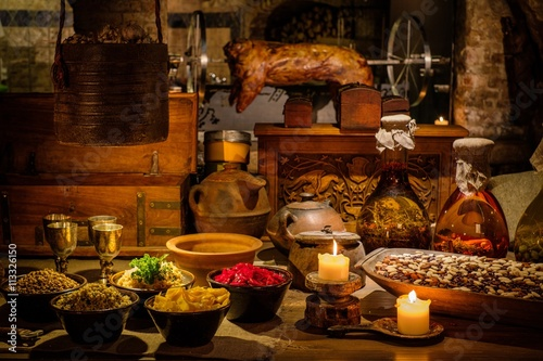 Obraz na plátne Medieval ancient kitchen table with typical food in royal castle.