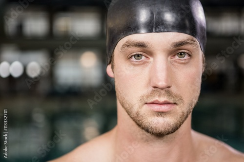 Portrait of swimmer standing by the pool Wallpaper Mural