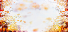 Autumn Blurred Bokeh Background With Branches And Leaves Of Trees And Blue Sky