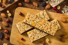 Granola Bars. Healthy Food: Energy Granola Bars With Cornflakes, Puffed Cereals And Rolled Oats Covered In Chocolate On Wooden Cutting Board
