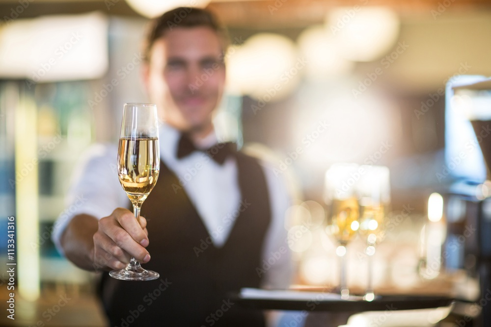 Waiter offering a glass of champagne Poster