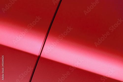 Surface of red sport sedan car, detail of metal fender and door of vehicle bodyw Wallpaper Mural