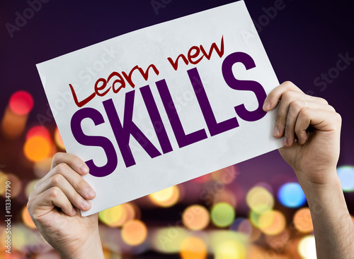 Learn New Skills placard with night lights on background Canvas Print