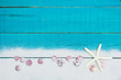 Blank sign with starfish, sand and seashells border