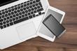 Responsive web designer desk with tablet, smartphone and open MacBook Pro