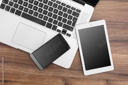 Fototapeta Responsive web designer desk with tablet, smartphone and open MacBook Pro obraz