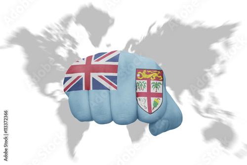 fist with the national flag of Fiji on a world map ...